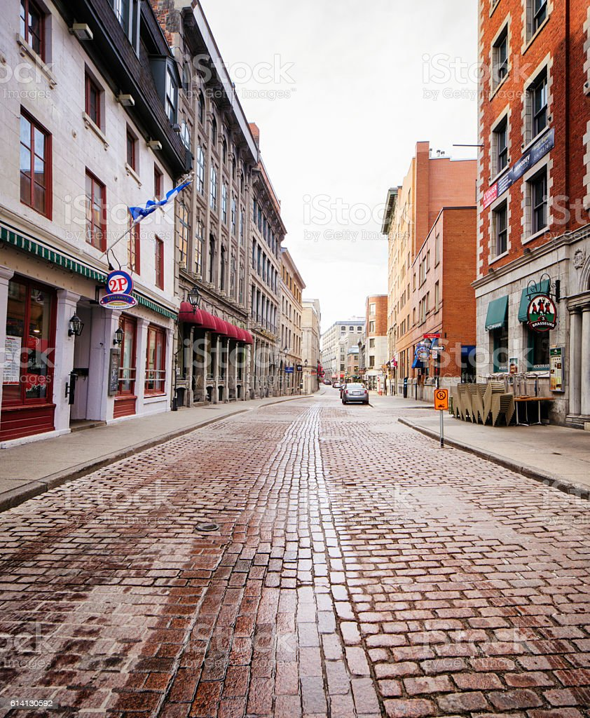 Old Montreal cobblestone  paved street Quebec Canada stock photo