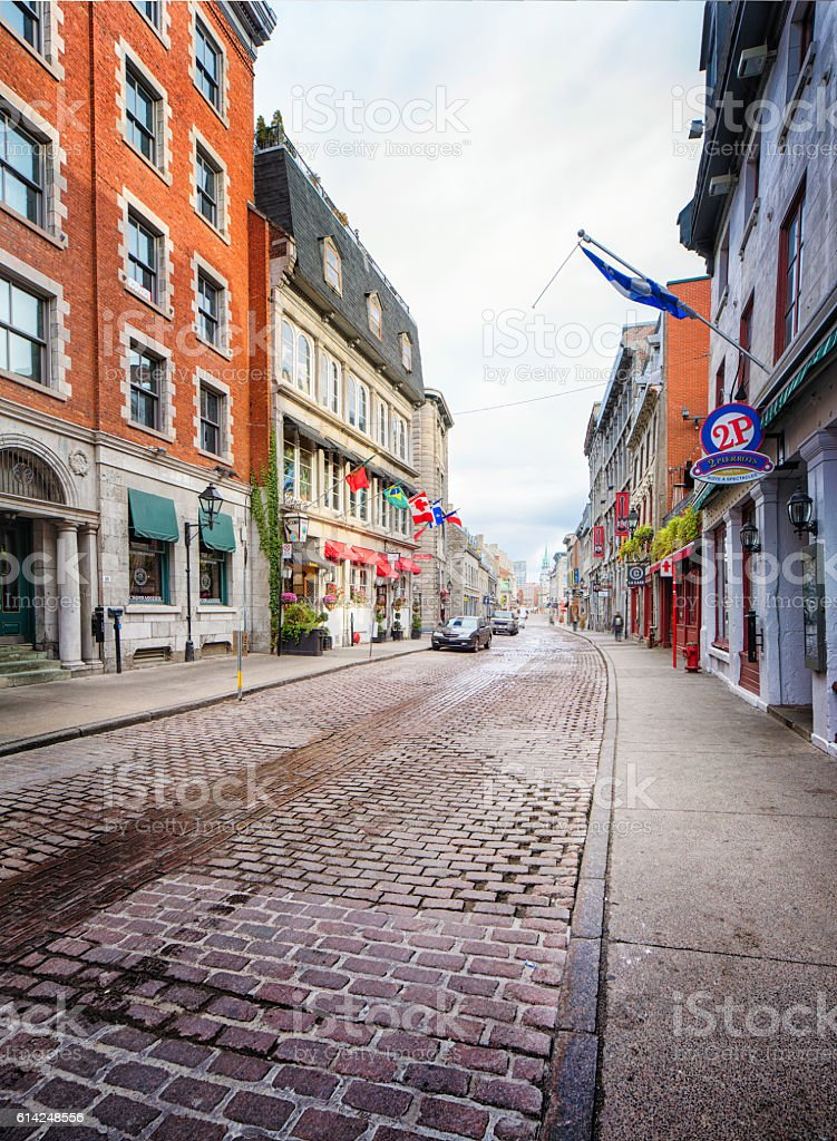 Old Montreal cobblestone paved winding street Quebec Canada stock photo