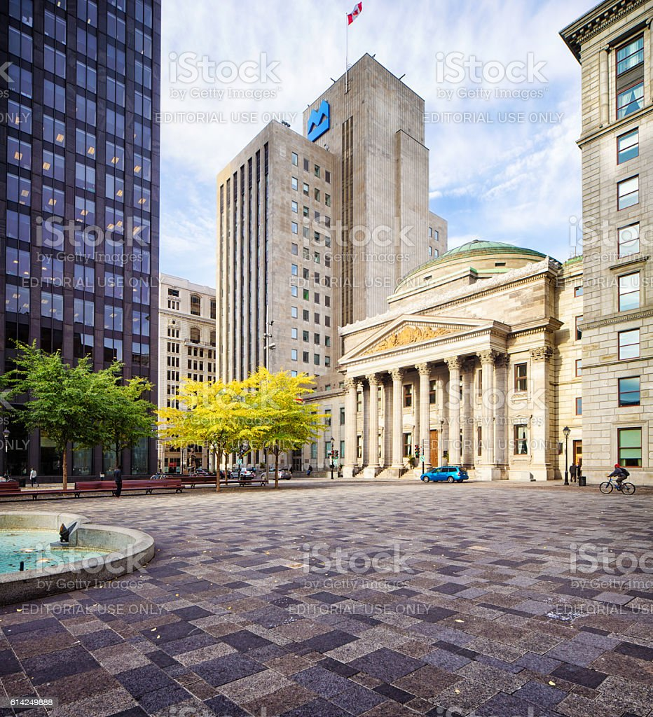 Old Montreal place d'armes with bank buildings stock photo