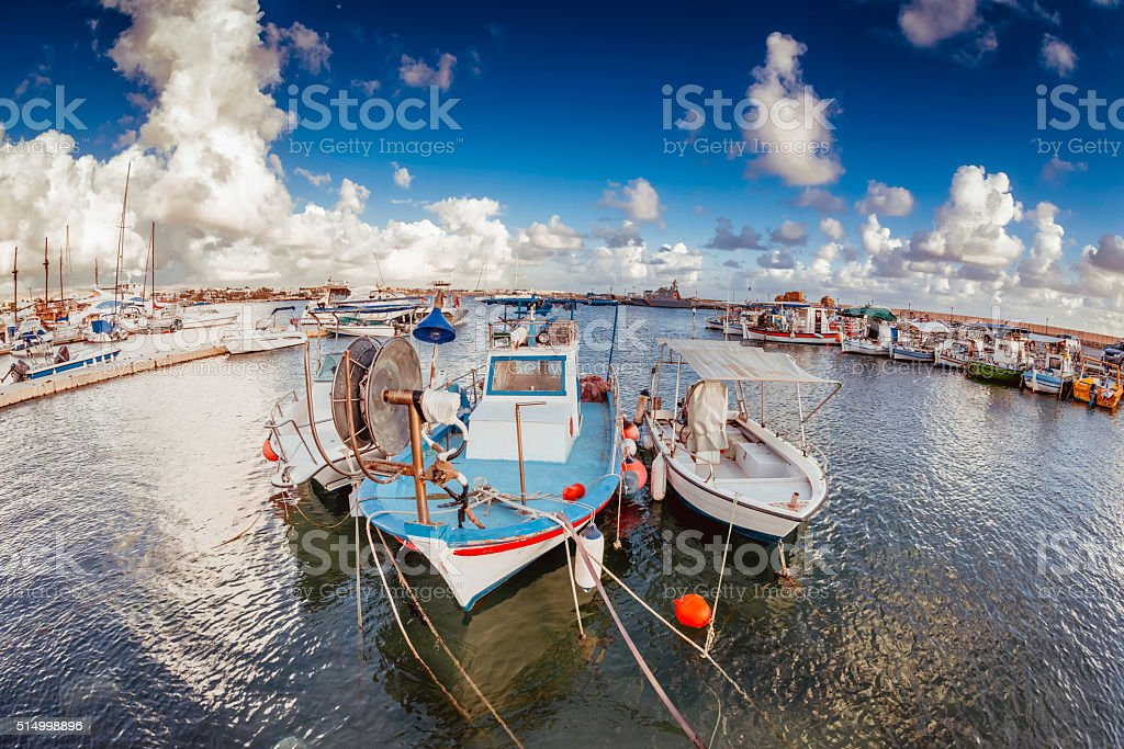 Old moored fishing boats in a Paphos harbour, Cyprus stock photo