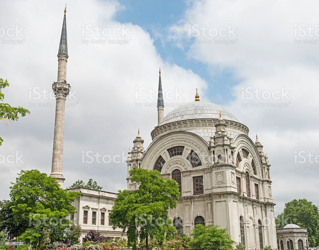 Old mosque against cloudy sky background stock photo