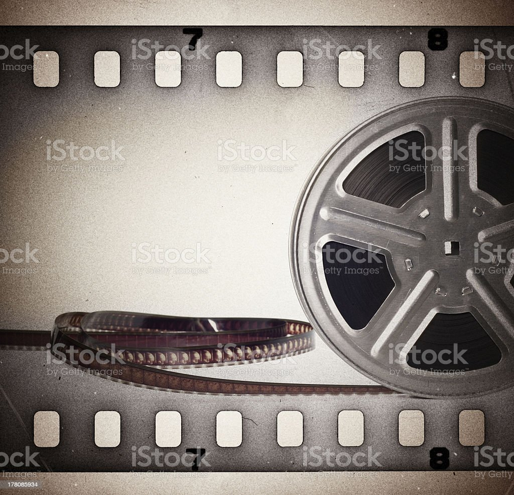 Old motion picture film strip reel. Vintage background stock photo
