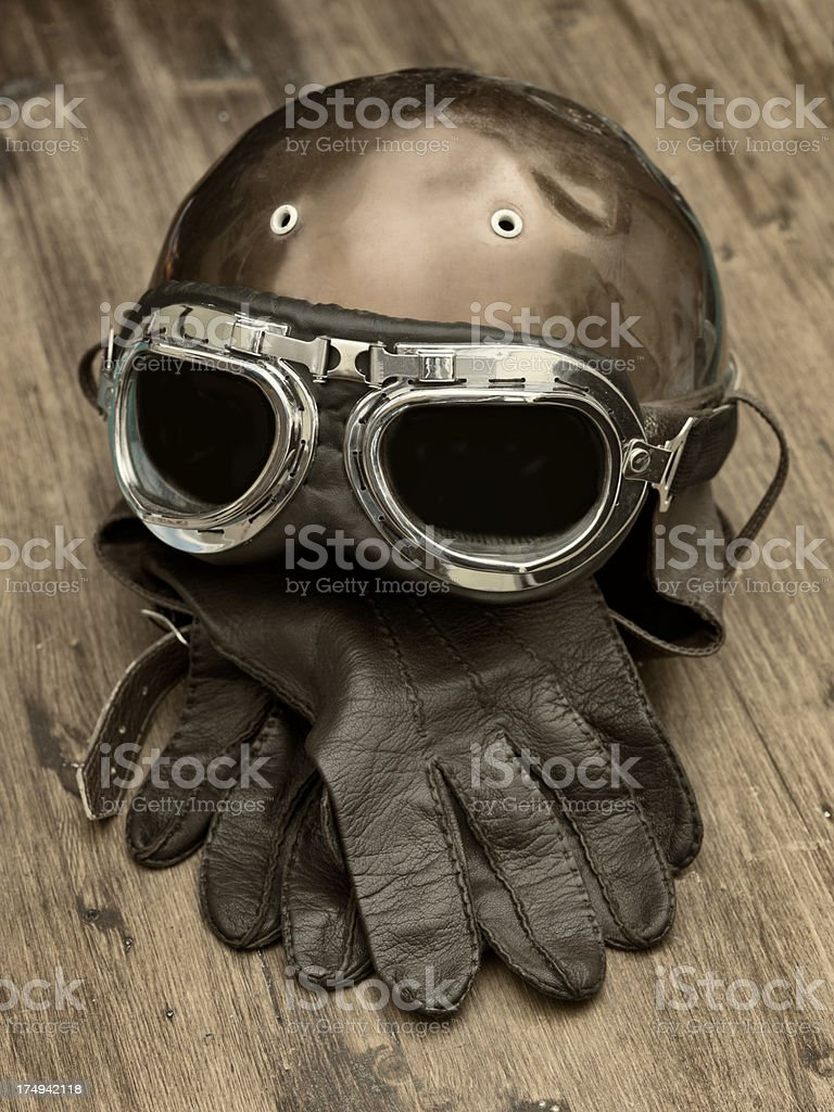 Old Motorcycle helmet and gloves stock photo