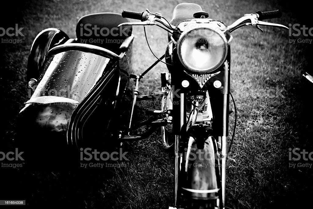Old motorcycle whit side car loader stock photo