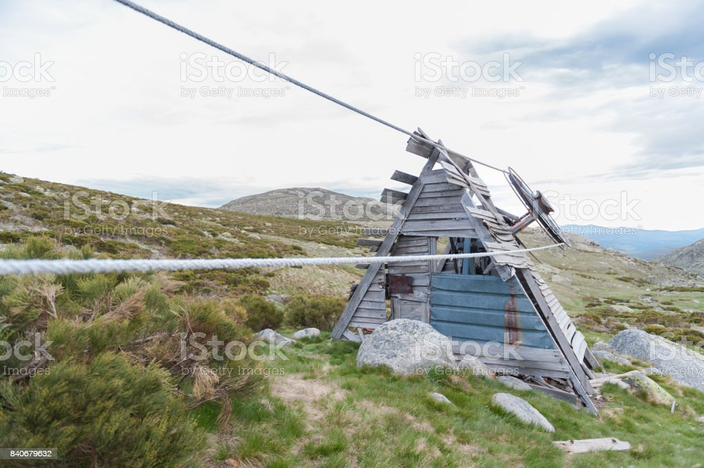 Old mountain lift built of wood and rope stock photo