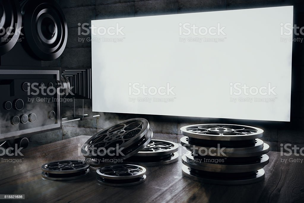 Old movie camera and film cartridge on a wooden table stock photo