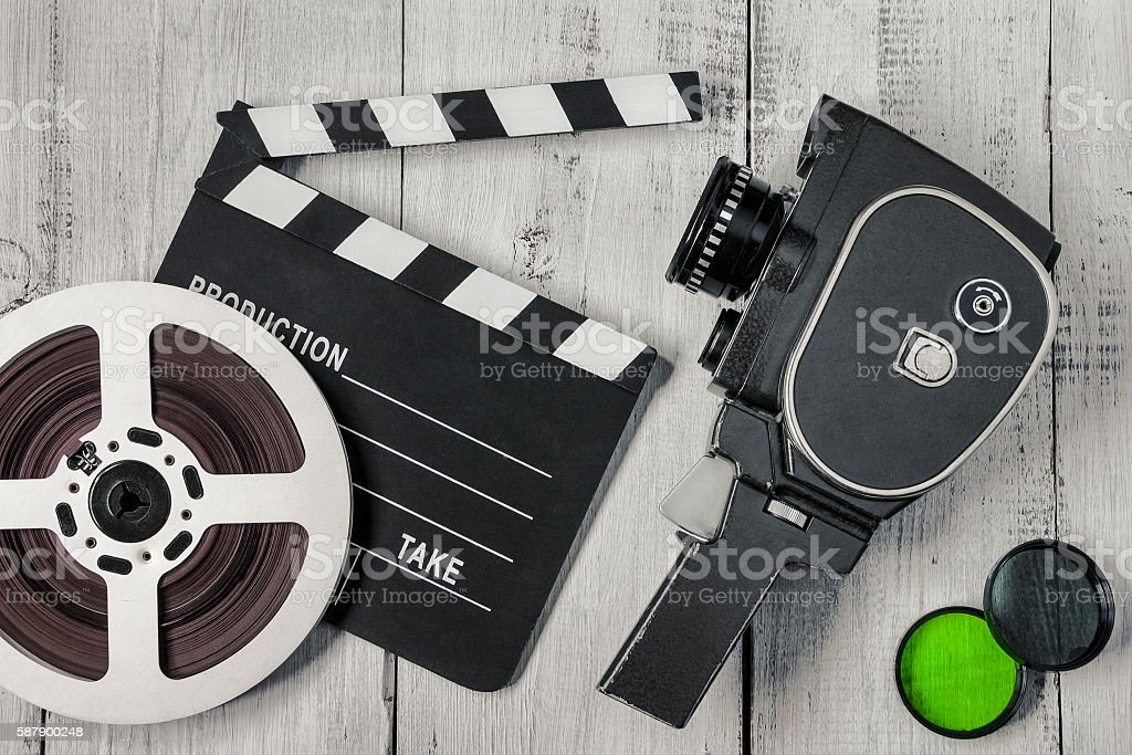 Old movie camera and film reel stock photo