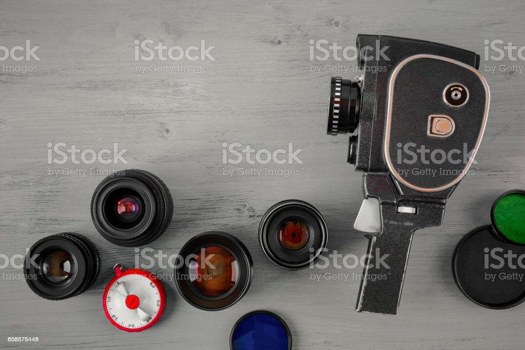 Old movie camera and several lenses stock photo