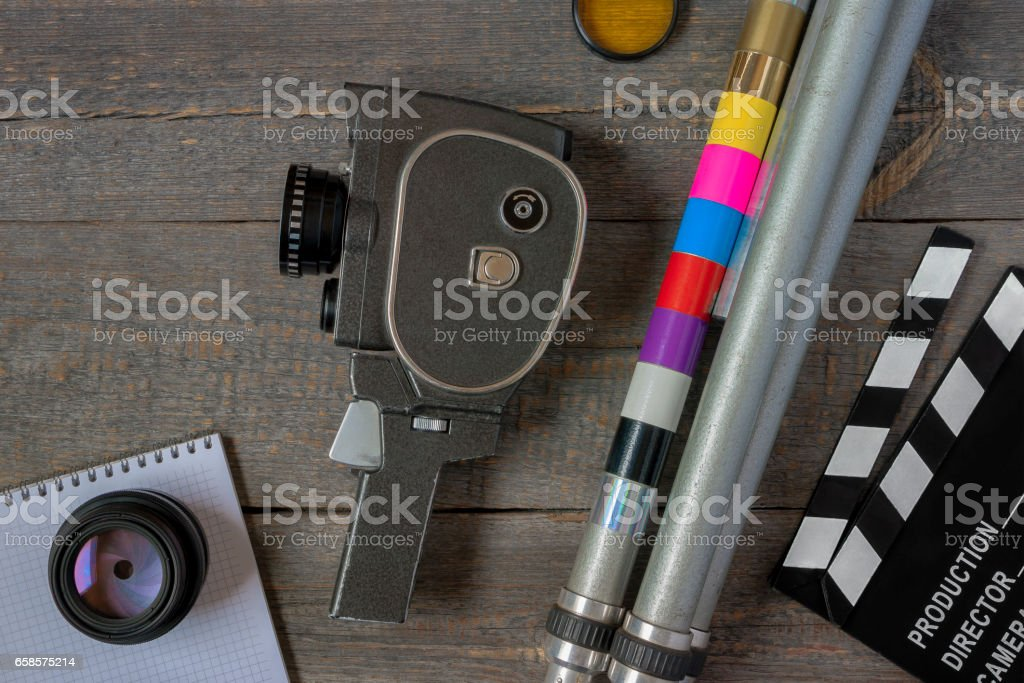 Old movie camera with a tripod and clapperboard stock photo