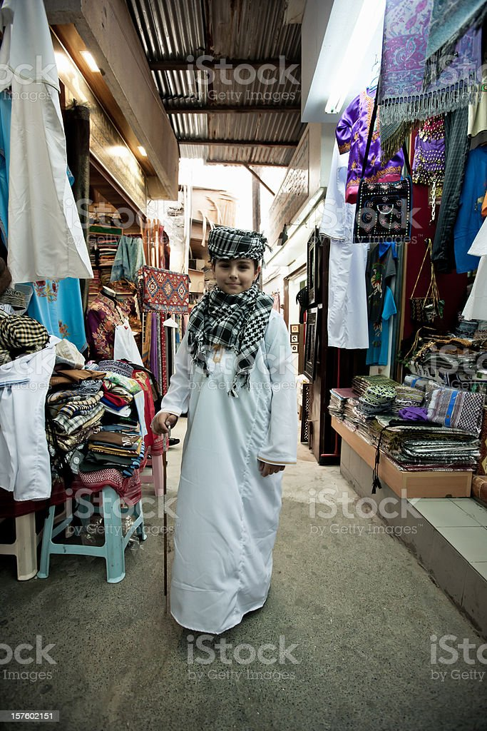 Old Muttrah Souk Happy Boy in Traditional Arabian Clothes Oman stock photo