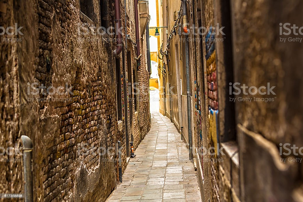 Old narrow alley in Venice stock photo