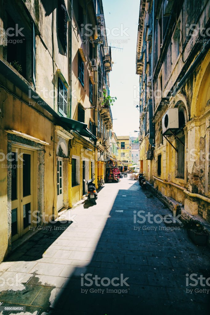 Kerkyra, Corfu Island, Greece - June 25, 2012: Old narrow street vintage edited stock photo