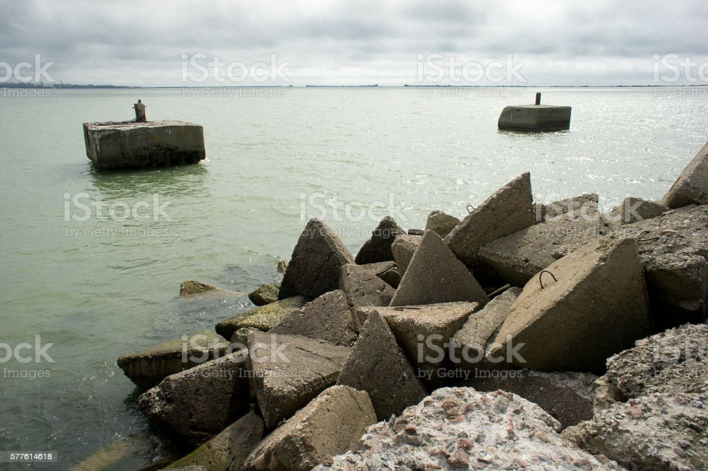 Old naval port. Crumbling remains of the port stock photo