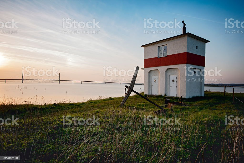 Old Navigation Hut Looking Over Farø Bridge in Denmark stock photo