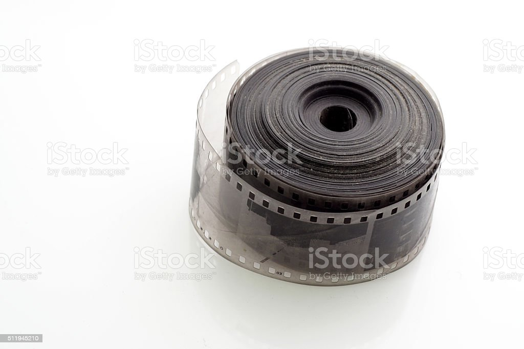 Old negative 35 mm film strip on white background stock photo