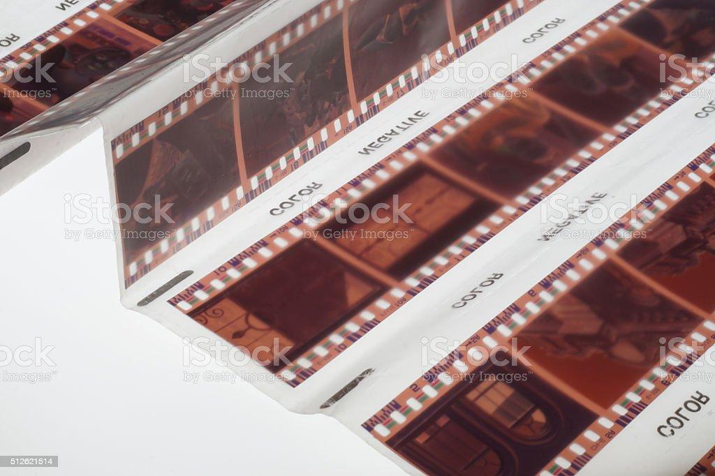 Old negative 35mm film strip on white background stock photo