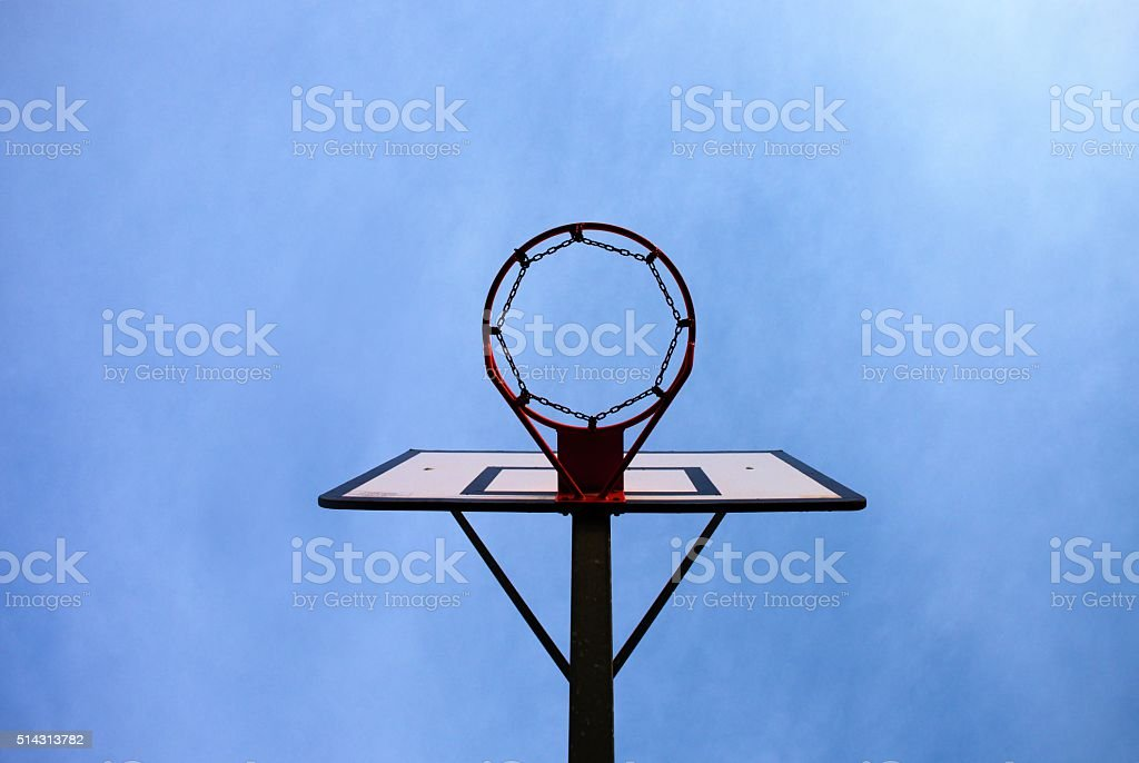 Old neglect basketball backboard with rusty hoop above street court. stock photo