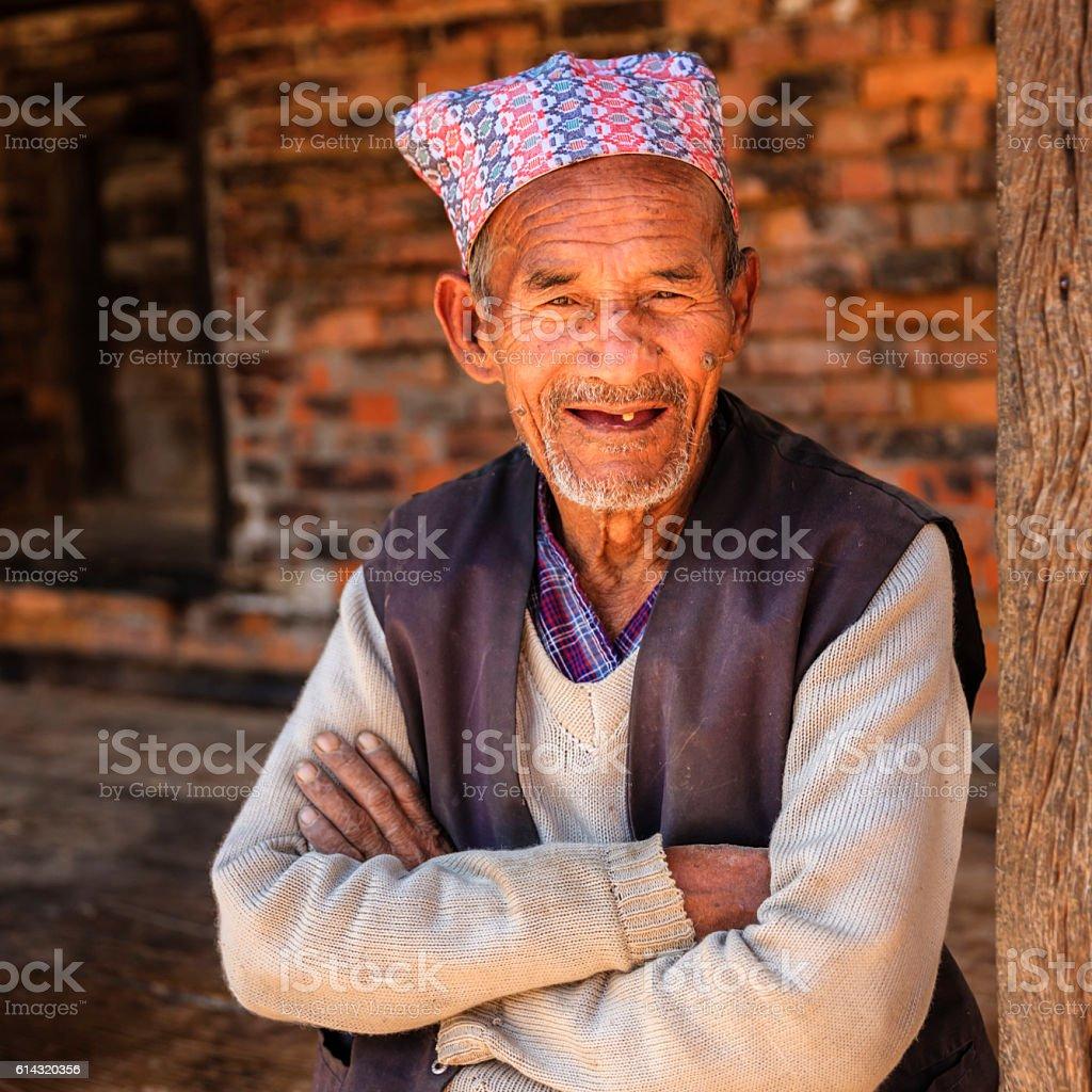 Old Nepali man resting in Bhaktapur stock photo
