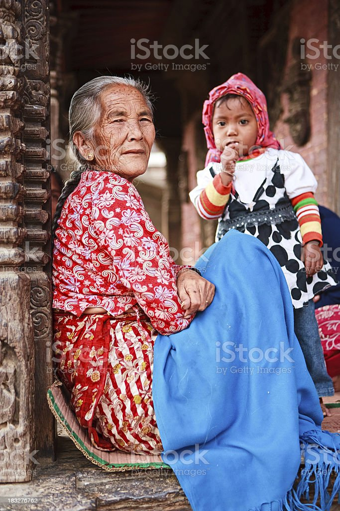 Old Nepali woman and her granddaughter royalty-free stock photo