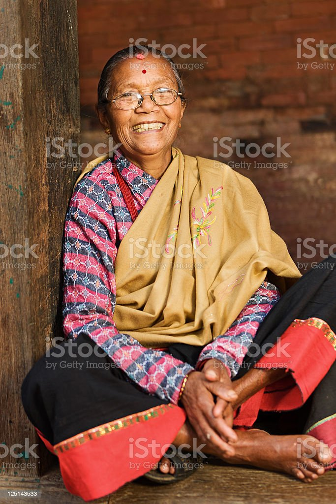 Old Nepali woman in Bhaktapur, Durba Square' stock photo