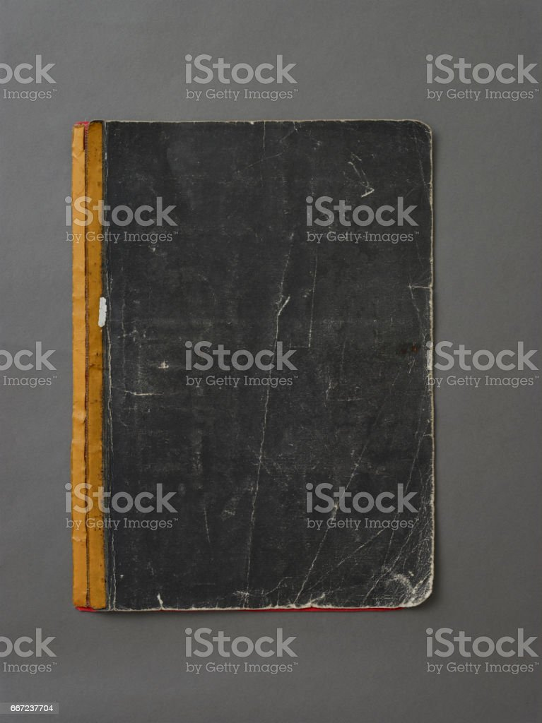 Old notebook cover on grey background stock photo
