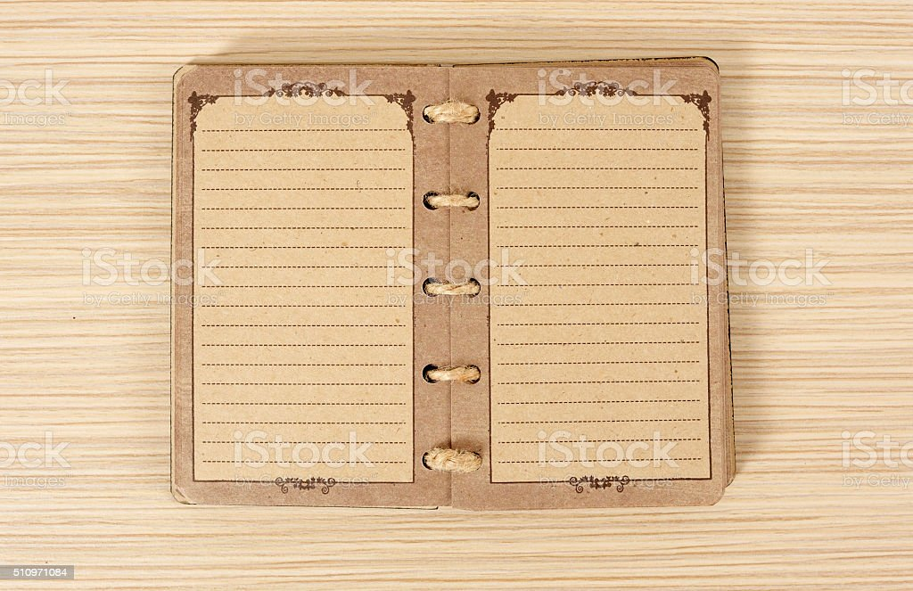Old notebook on table stock photo