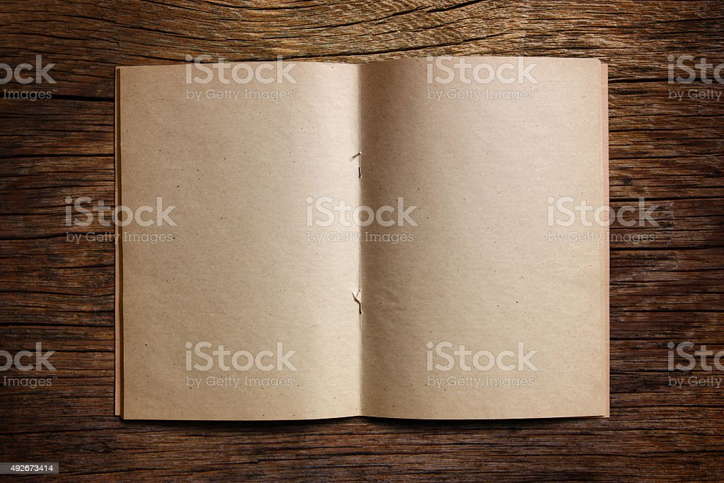 Old notebook on the table. stock photo