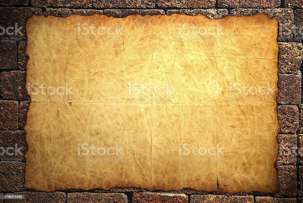 Old notebook paper on wall background royalty-free stock photo