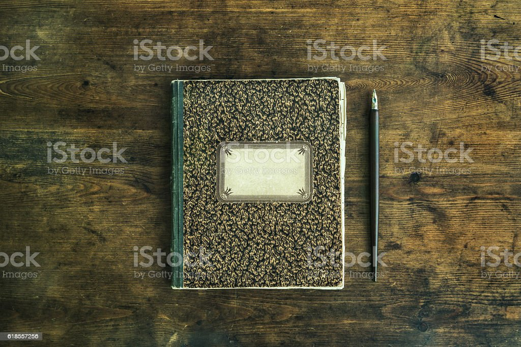 Old notebook with pencil stock photo