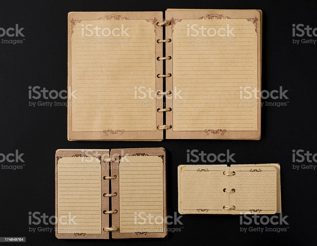 Old notebooks on black background royalty-free stock photo