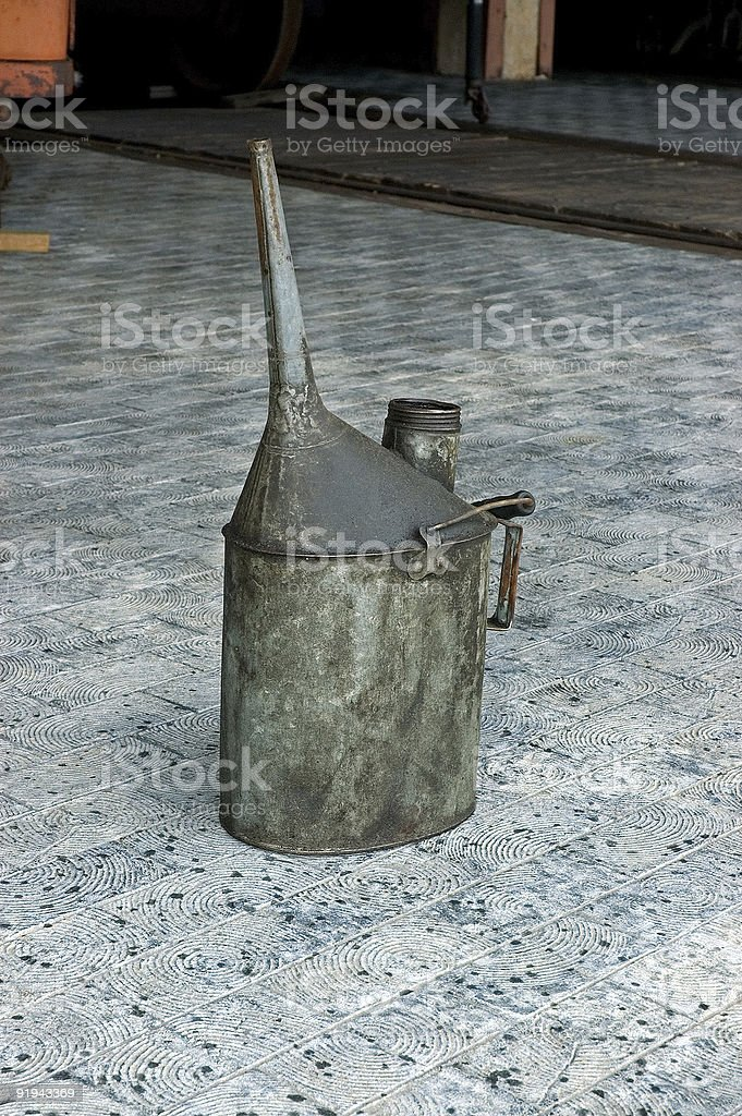 Old Oil Can at Train Station royalty-free stock photo