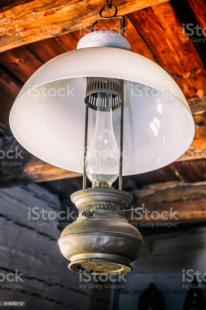 Old oil lamp in the room stock photo
