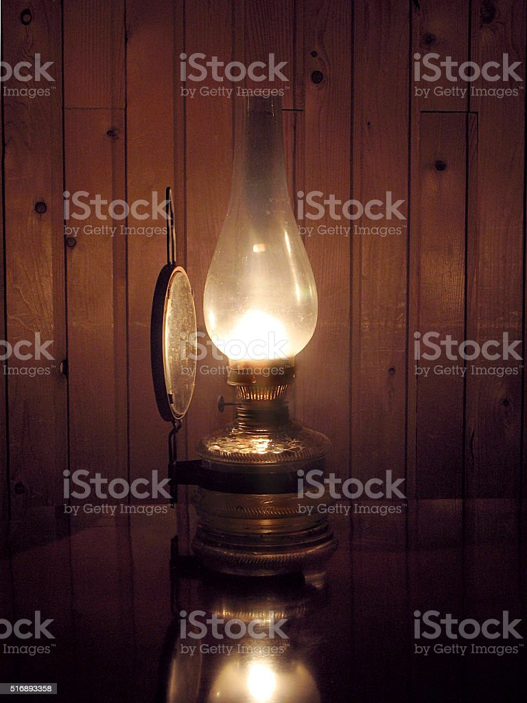 Old oil lamp on the desk stock photo