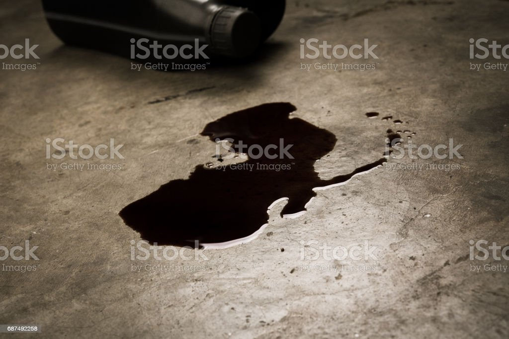 Old oil of car motor engine used spill on concrete floor and bottle stock photo