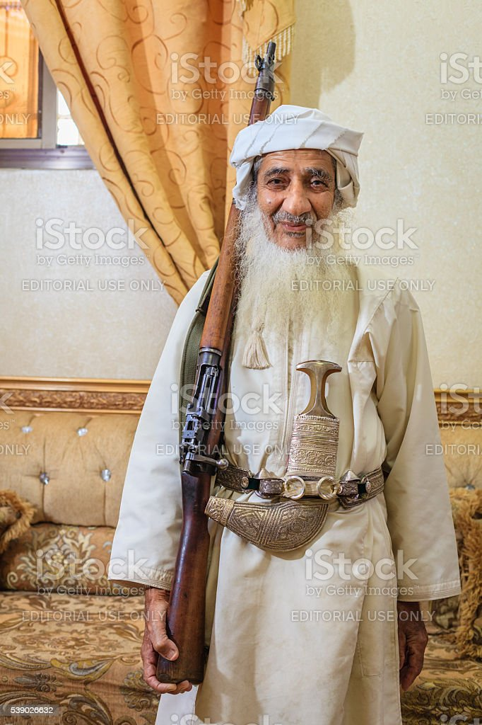 Old Omani man in traditional outfit stock photo
