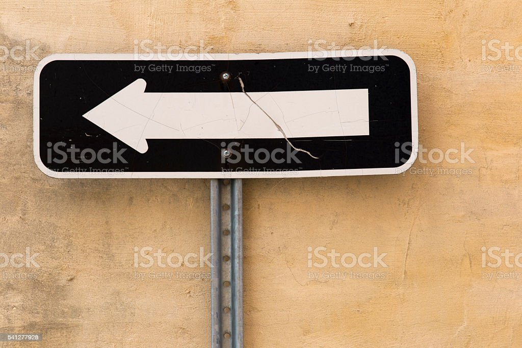 Old One-way traffic sign stock photo