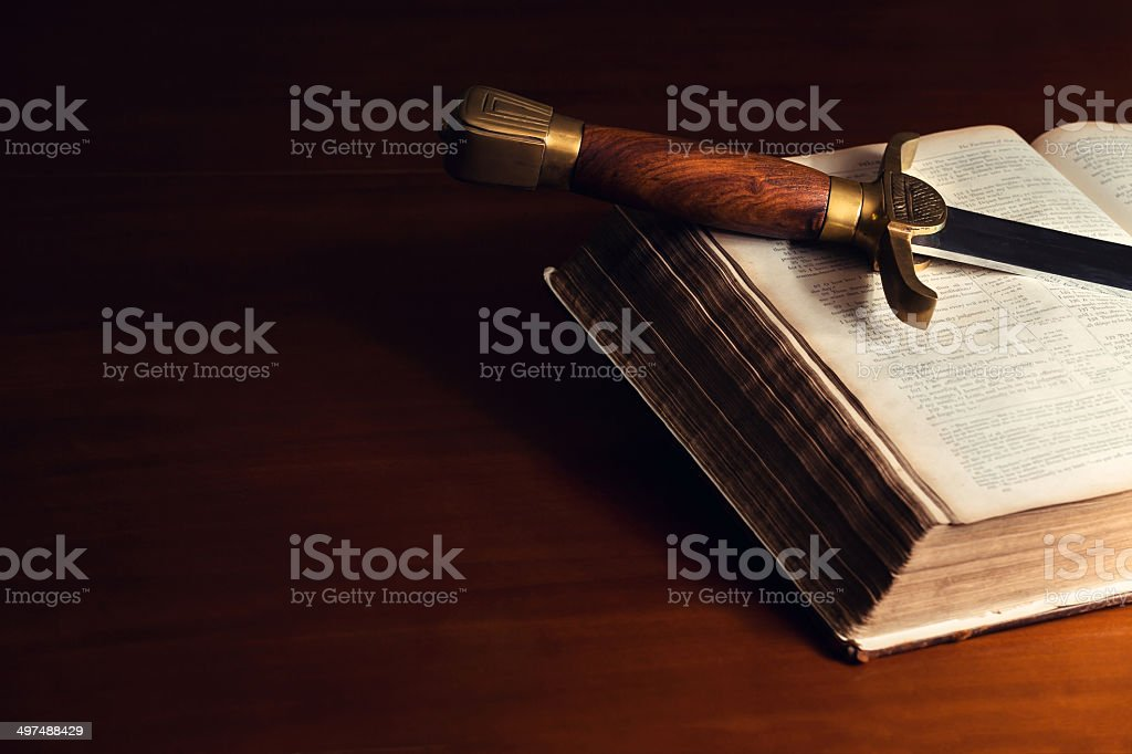 Old Open Bible With Sword stock photo