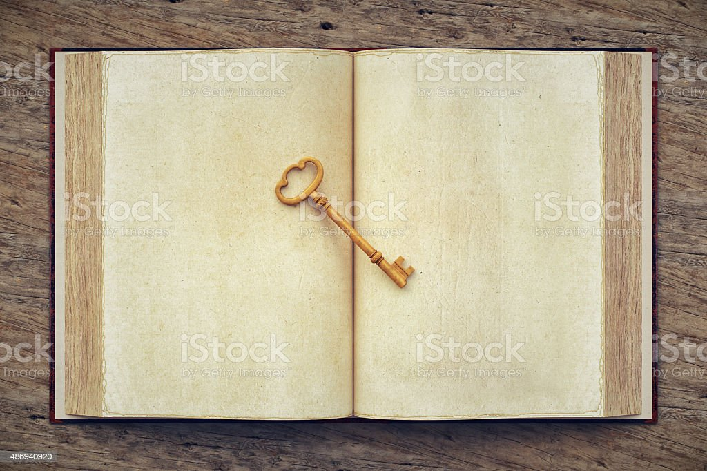 Old Open Book And Skeleton Key stock photo