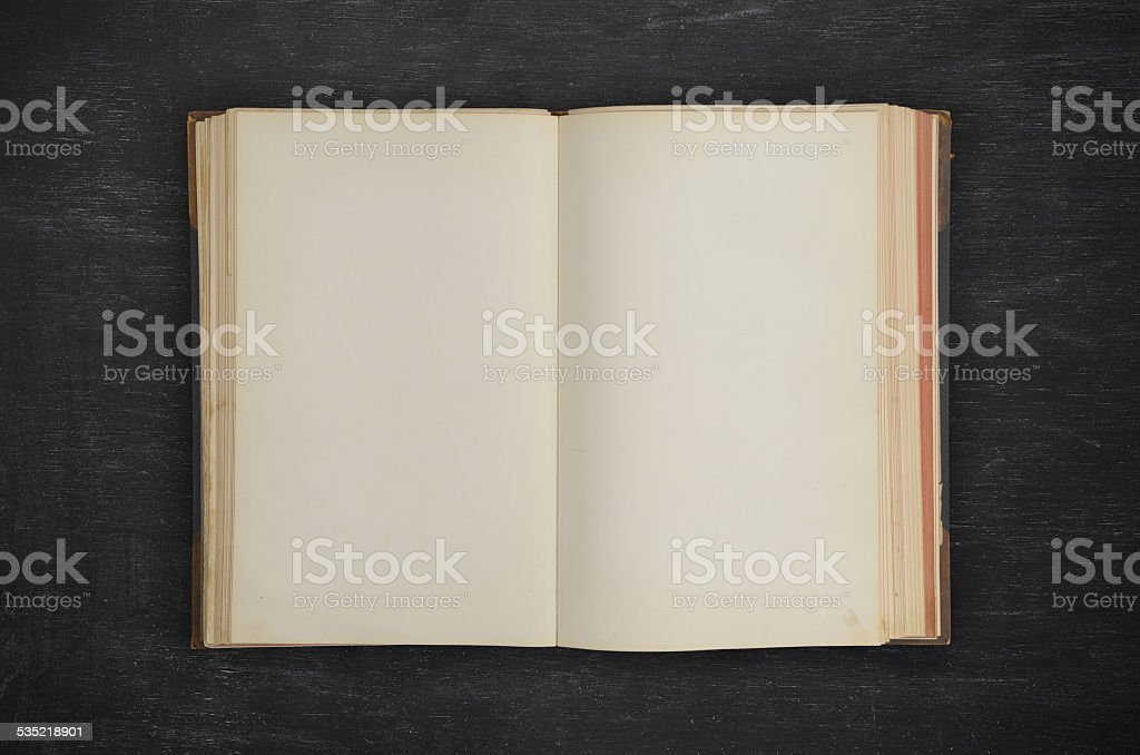 old open book on black wood stock photo