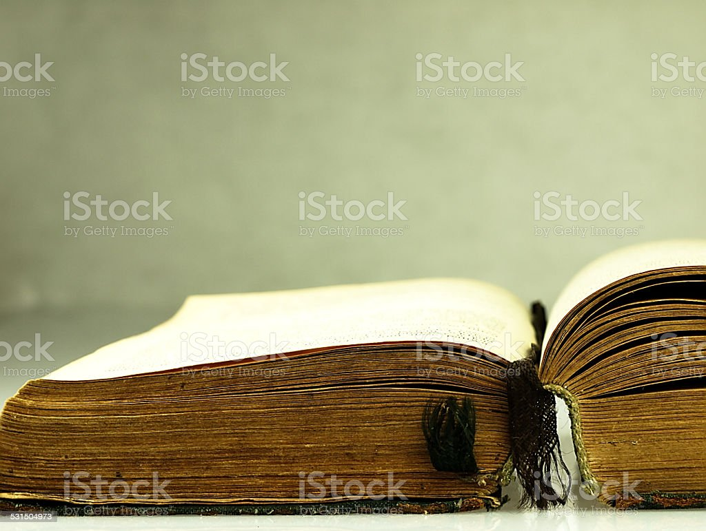 Old, open book with a damaged cover. stock photo