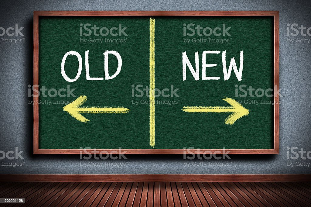 old or new on chalkboard stock photo
