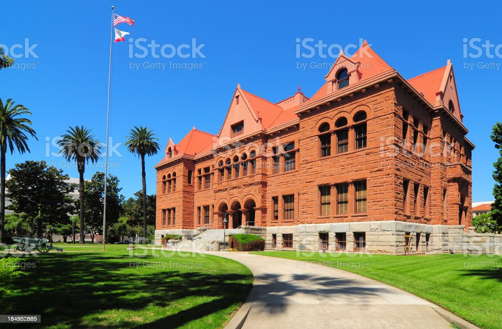 Old Orange County Courthouse and palm trees in the sun stock photo