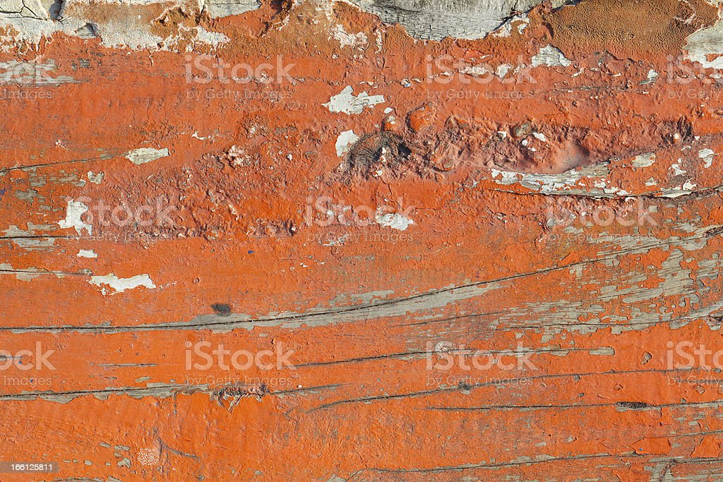 old orange paint texture peeling off wood plank background royalty-free stock photo