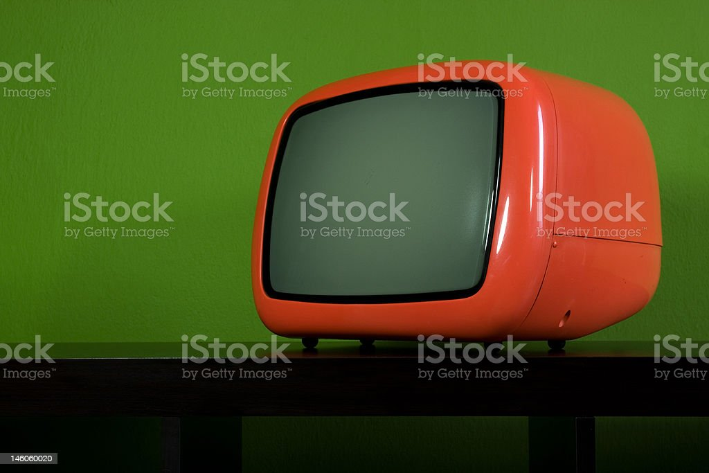 Old orange television in green room royalty-free stock photo