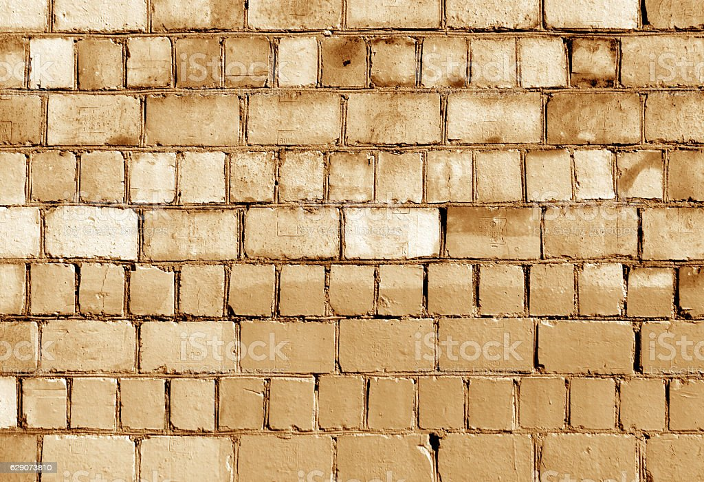 Old orange toned brick wall texture stock photo