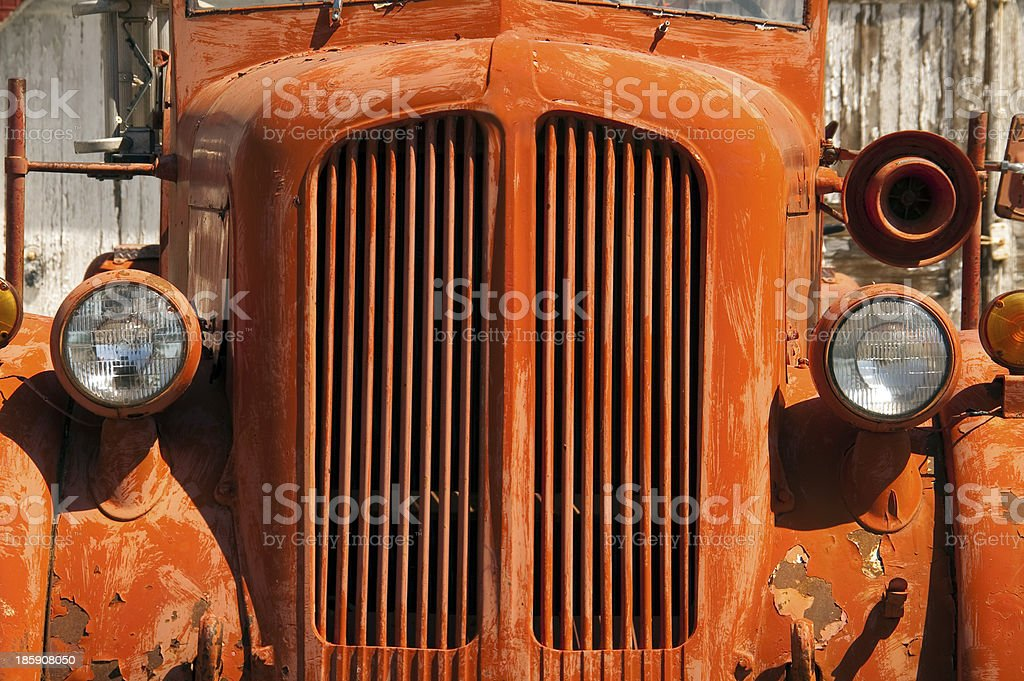 Old Orange Vintage Fire Truck Sits Rusting in Desert Country royalty-free stock photo