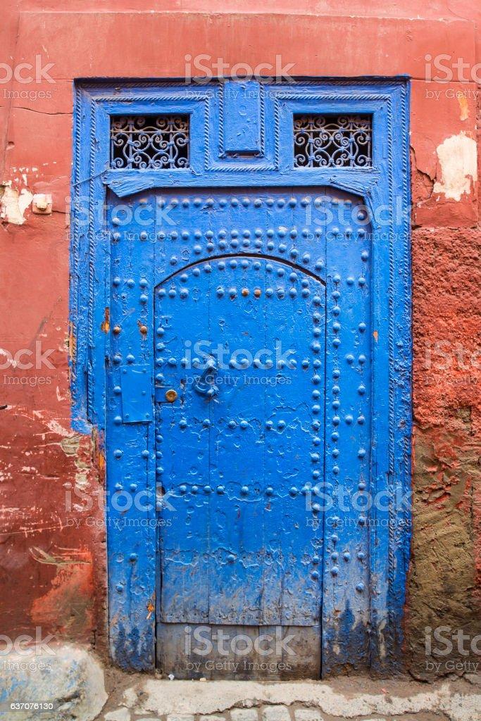 Old oriental door in the souk of Marrakesh, Morocco stock photo