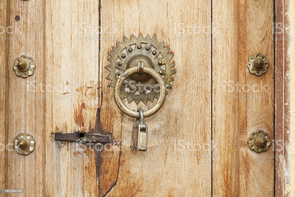 Old Ornate Door Knocker With Padlock stock photo