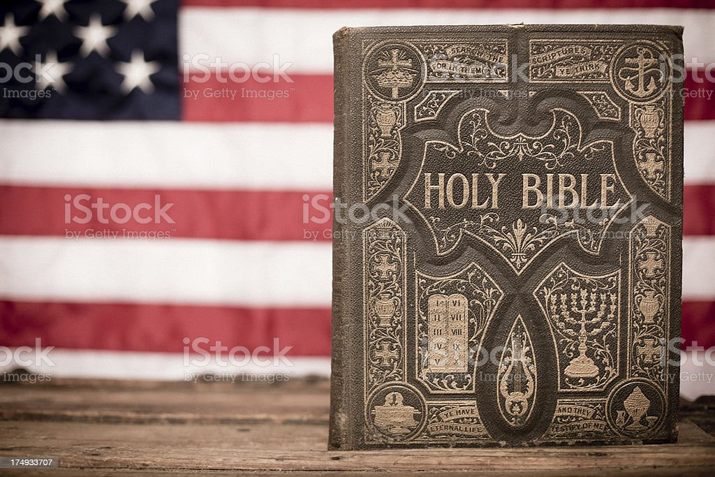 Old, Ornate Holy Bible With American Flag Backgroun royalty-free stock photo