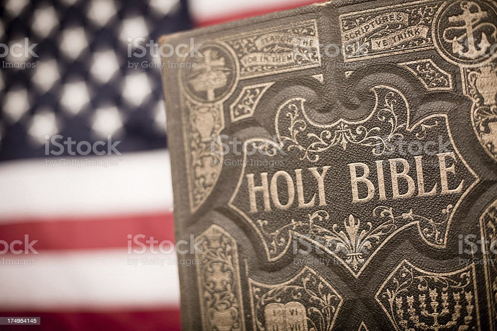 Old, Ornate Holy Bible With American Flag Background stock photo